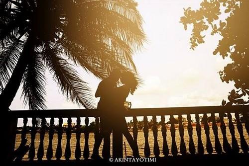 newlywed couple on honeymoon - playing outside
