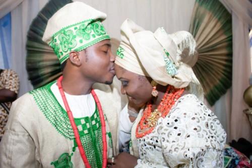 yoruba wedding groom kisses brides forehead