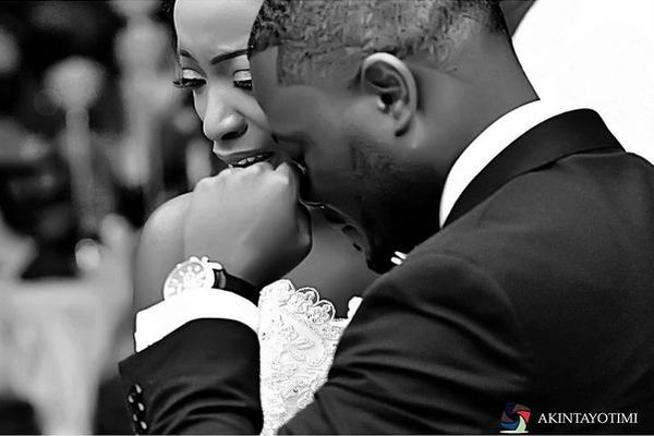 image: groom and bride in a teary moment