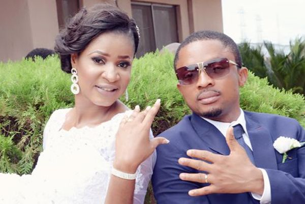 couple pose for pictures at their benin white wedding