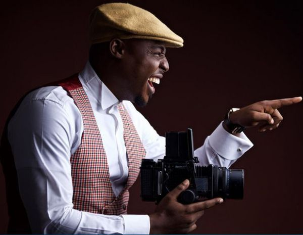 image of a nigerian wedding photographer snapping away