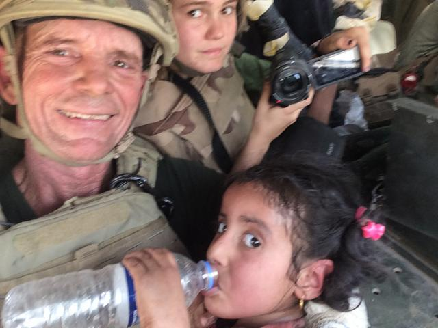 Dave Eubank in the Humvee with the girl after the rescue