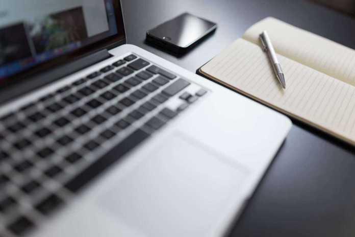 laptop writing notepad