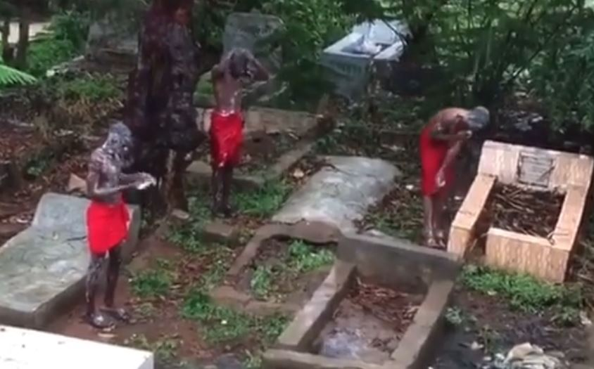 VIDEO: Suspected Yahoo Boys Chant Incantations as they Bath in Cemetery