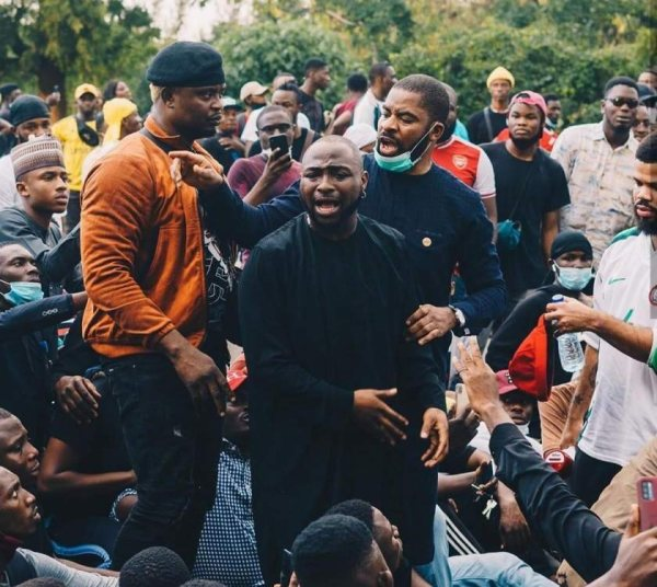 Davido Goes Down On His Knees To Beg For The Release Of 20 Protesters