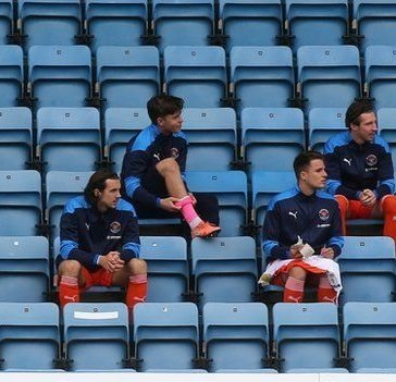Substitutes sitting in the stands