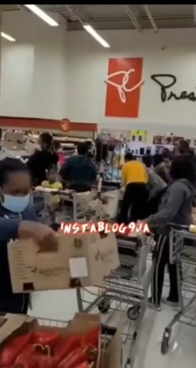 Nigerians Struggling Over Boxes Of Pepper At A Store In Canada
