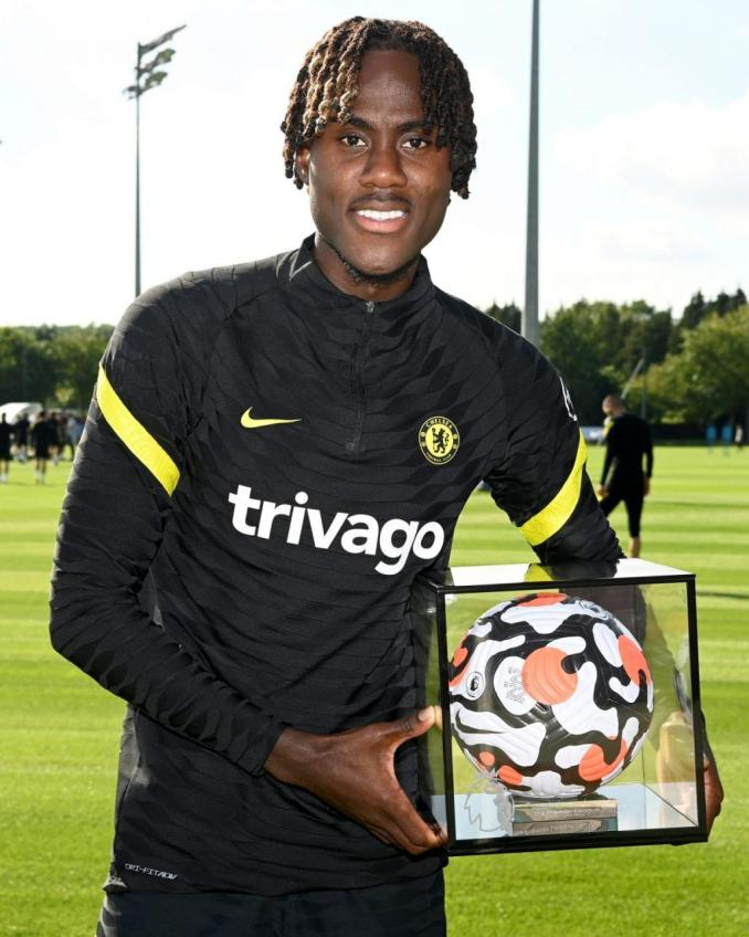Chelsea's Left again Trevor Chalobah receives his goal of the month trophy