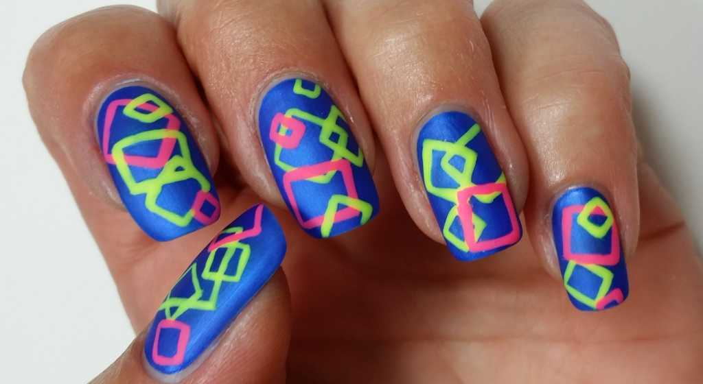 Enjoy Your Joyful Spring Nail Design That Is Made Up From A Matte Zaffre Blue Colored Base Decorated With Some Huge Colorful Squares The Neon