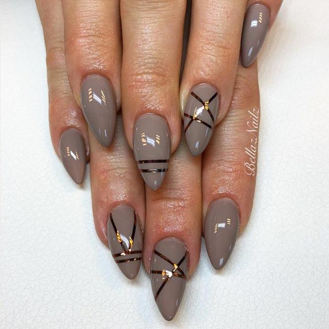 مسامير داكنة اللون مزينة بخطوط معدنية # أظافر طويلة # أظافر لامعة # أظافر
