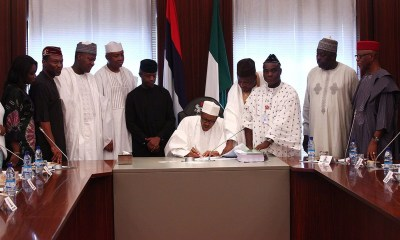 President Buhari signing 2019 Budget, List of President Buhari's Cabinets, Ministries Departments and Agencies of Nigeria