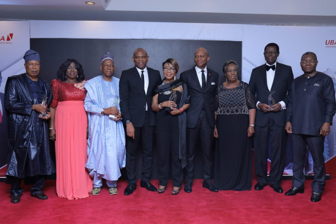 Appreciating Meritorious Services: L-R: Former Non-Executive Director, Alhaji Jafaru Paki; Emeritus Professor Mercy Olumide; Former Non-Executive Director, Ambassador Adekunle Olumide; Chairman, UBA Plc, Mr. Tony Elumelu; Former Non-Executive Director, Mrs. Rose Okwechime; GMD-CEO, Kennedy Uzoka; Former Non-Executive Director, Mr Zekeri Yahaya and wife Clara, during the send forth cocktail and dinner held by the Bank for the former Non-Executive Directors, held at Transcorp Hilton, Abuja on Friday