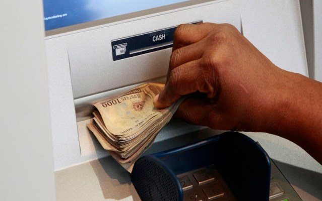 CBN's new bank charges takes off today, Customers blame long queue in banking halls on banks new ATM withdrawal limits