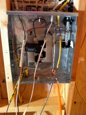 The interior of the breaker box as the electrician was beginning to wire it.