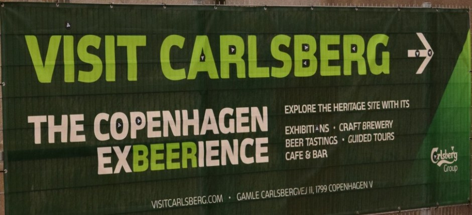 Visit Carlsberg sign that will guide you to the entrance of a new aventure.
