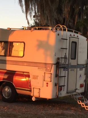 big-foot-pickup-camper-naked-hippie-roadtrip