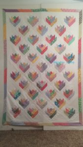 Floral Bouquet finished quilt top using the Pam & Nicky Lintot book