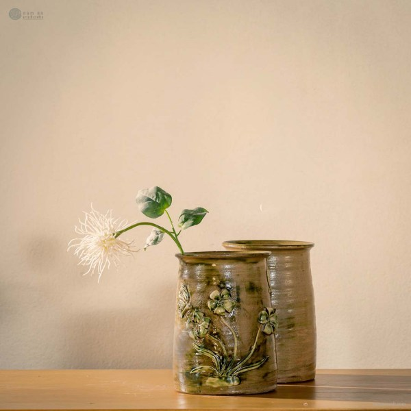spring-scenery-embossed-vase-with-flower-and-butterfly-pattern-made-by-artist-pham-anh-dao