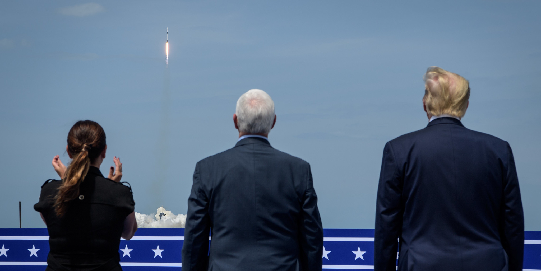President Donald Trump, right, Vice President Mike Pence, and Second Lady Karen Pence watch the launch of a SpaceX Falcon 9 rocket carrying the company's Crew Dragon spacecraft on NASA's SpaceX Demo-2 mission with NASA astronauts Robert Behnken and Douglas Hurley onboard, Saturday, May 30, 2020, from the balcony of Operations Support Building II at NASA's Kennedy Space Center in Florida.