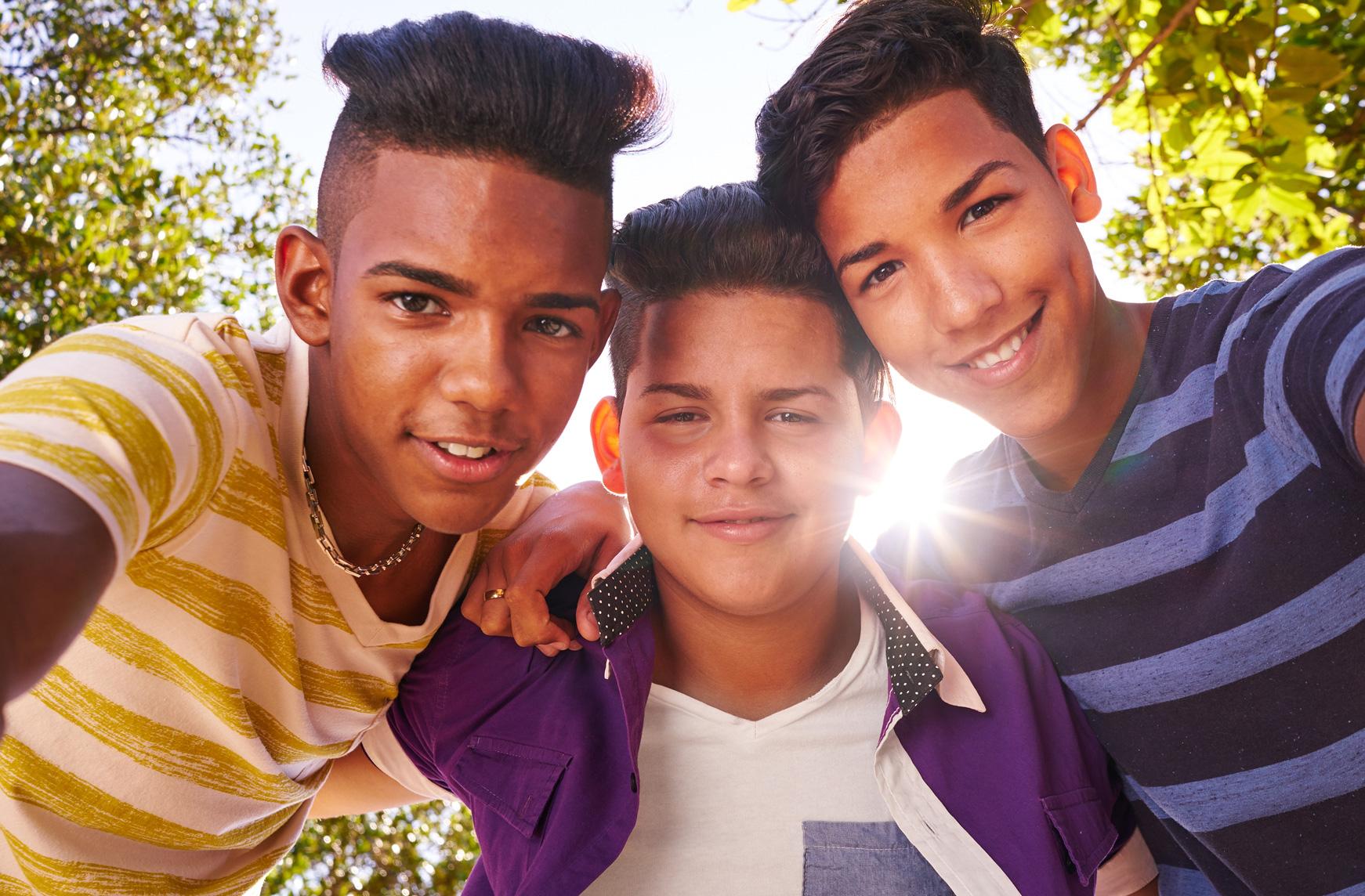 three teen boys smiling namaste family services