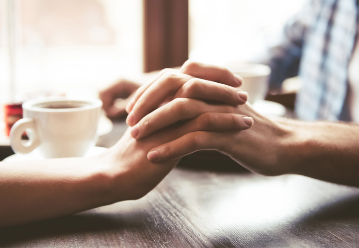couple holding hands namaste family services
