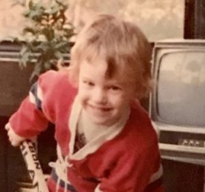 Billy McDaddy in the greenhouse at 136 West Swissvale Ave, posing for hockey.