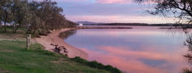 Sunset with red clouds refelcting in the Nambucca River estuary.