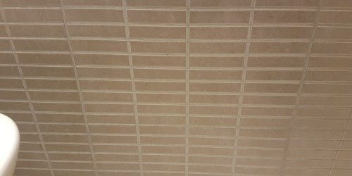 CRACKED BATH PANEL TILE REPAIRS AFTER