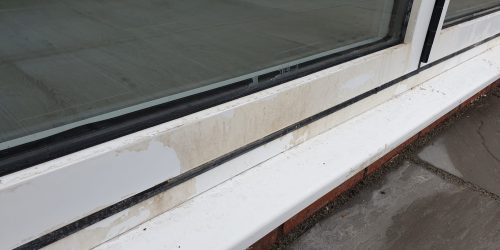 BADLY STAINED POWDER COATED WINDOW FRAME REPAIR BEFORE