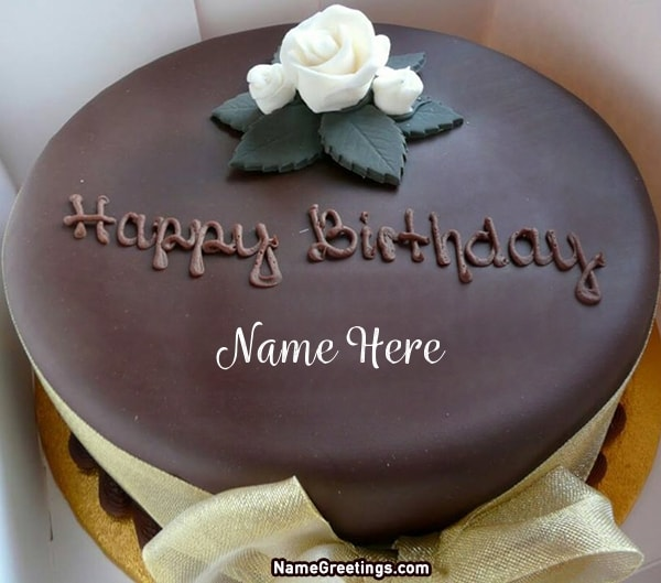 Write Name On Chocolate Cake With White Flower