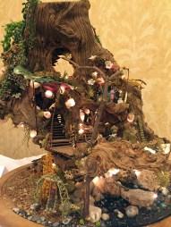 "NAME Member, Pamela Teal displayed ""Nature's Wonderland"" which included lighted shell lanterns."