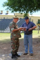 Major Charles de Cruz shows the program notes to Andrew Schofield who will be making a DVD of the 2012 Tattoo