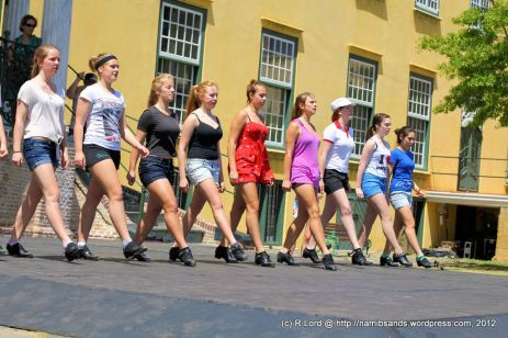 The long-legged beauties of the Celtic Dance troupe practice their steps on the stage