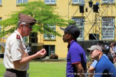 Lt Col Nijeboer explains to an usher what he needs to do in an emergency