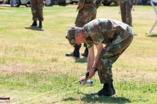 Major Ian Long measures out two identical arenas on the rear field - so that the different groups of participants can rehearse their routines in parallel