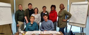 A group of newly trained Peer-to-Peer mentors stand with the trianing facilitators
