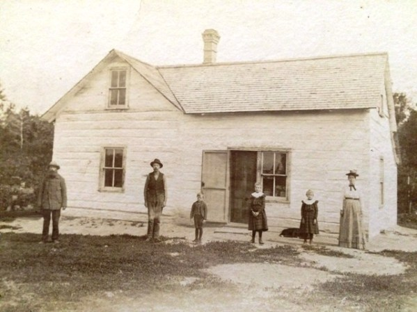 Petersons in front of house