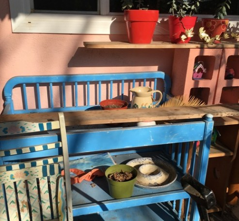 blue changing table with items