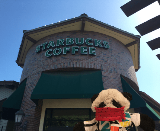 a starbucks behind