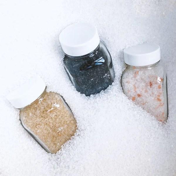 3 bottles of bath salts bury in salts