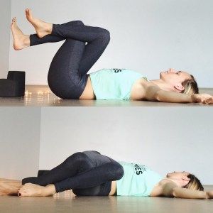 Release your grip on the feet/shins keeping the legs lifted and crossed. Open the arms wide like the letter T. On an exhale, drop the knees to the left and send the gaze to the right.