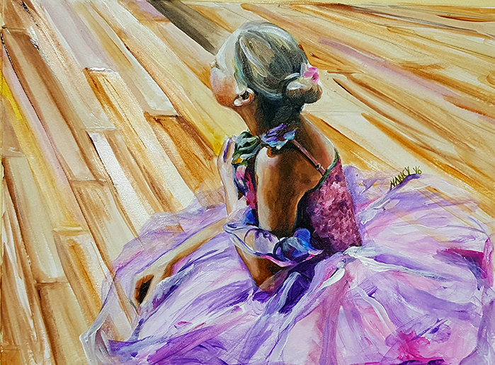 Blonde 10 year old girl in a pink tutu sits on a hard wood floor of a studio