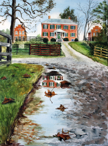A puddle on a gravel road reflects three house up on a hill. In the center is Smithfield Farm Manor house that dates to 1824. There are sycamore leaves in the puddle.