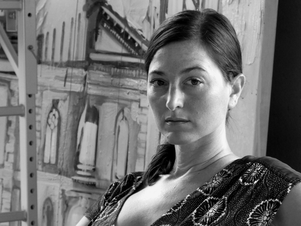 Monica in her studio - in front of painting - horizontal orientation -bw