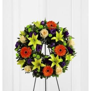 Corona fúnebre de colores