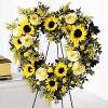 Corona funeraria con girasoles