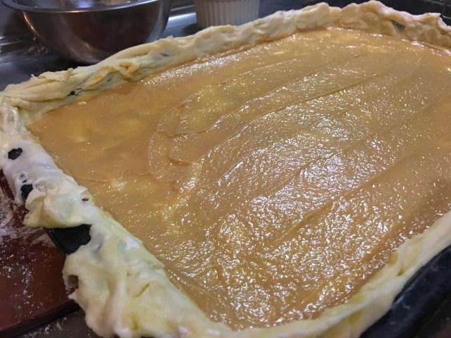 sweet tahini filling spread across dough