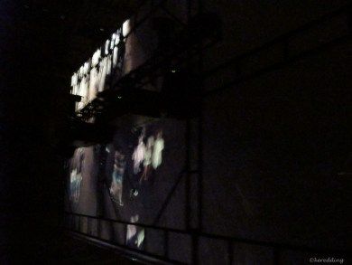 A view from the rear of a large projection screen.