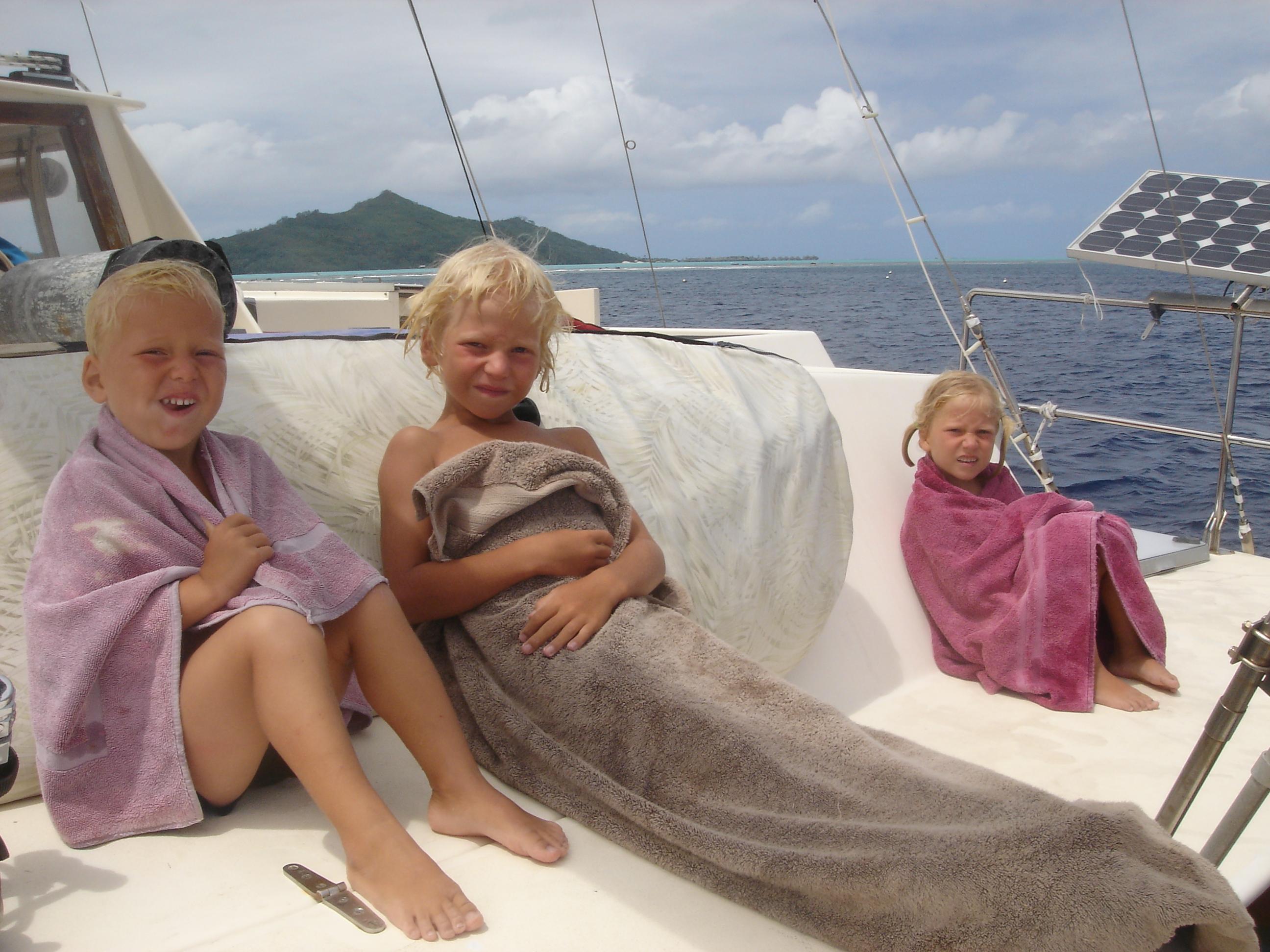 kids on the back of strange boat