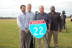 Posed with the new I-22 sign Friday morning are Aldermen Will Tucker and Johnny Anderson, Mayor Tim Kent, and Alderman Kevin Dale White.